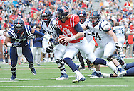 Quarterback Bo Wallace (14) scrambles during Mississippi's Grove Bowl controlled scrimmage at Vaught-Hemingway Stadium in Oxford, Miss. on Saturday, April 5, 2014.