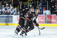 KELOWNA, CANADA - FEBRUARY 18: Cody Thiel #5 and Turner Elson #10 of the Red Deer Rebels  skate on the ice as the Red Deer Rebels visit the Kelowna Rockets on February 18, 2012 at Prospera Place in Kelowna, British Columbia, Canada (Photo by Marissa Baecker/Shoot the Breeze) *** Local Caption ***