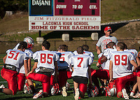 Coach Craig Kozens talks to his team during Thursday afternoon's practice.  (Karen Bobotas/for the Laconia Daily Sun)