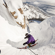 Steep & Deep participants drop into Corbet's Couloir after their instructor.