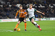 Hull City defender Michael Dawson (21) and Barnsley FC midfielder Brad Potts (20)  during the EFL Sky Bet Championship match between Hull City and Barnsley at the KCOM Stadium, Kingston upon Hull, England on 27 February 2018. Picture by Ian Lyall.