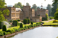 Forde Abbey, a former Cistercian monastery surrounded by Yew topiary, herbaceous borders and the long pond in Chard, Dorset, UK