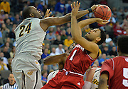 March 20, 2015: Wichita State Shockers forward Shaquille Morris (24) blocks a shot by Indiana Hoosiers guard James Blackmon Jr. (1) during a second round game between No. 7 Wichita State and No. 10 Indiana in the 2015 NCAA Men's Basketball Championship Tournament at CenturyLink Center in Omaha, Neb. Wichita State defeated Indiana 81-76.