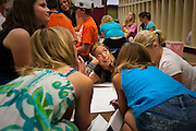 Jayden Dingman, center, thinks hard about how she would spend $1,000,000 dollars during an exercise organized by Horizing Credit Union to help expand fourth through sixth graders financial literacy at Ramsey Elementary on Friday.