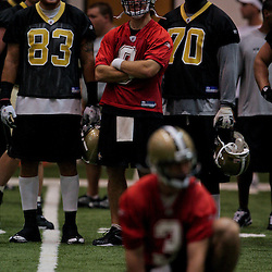 18 June 2009: Saints players, Billy Miller (83), Drew Brees (9) and Jammal Brown (70) watch special teams drills from the sideline during the New Orleans Saints Organized Team Activities held at the team's indoor practice facility in Metairie, Louisiana.