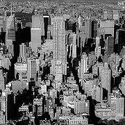 The Empire State Building front and center as we look northward from a helicopter above Manhattan.