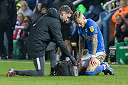 Joe Ward (23) receives attention during the EFL Sky Bet League 1 match between Peterborough United and Rotherham United at London Road, Peterborough, England on 25 January 2020.