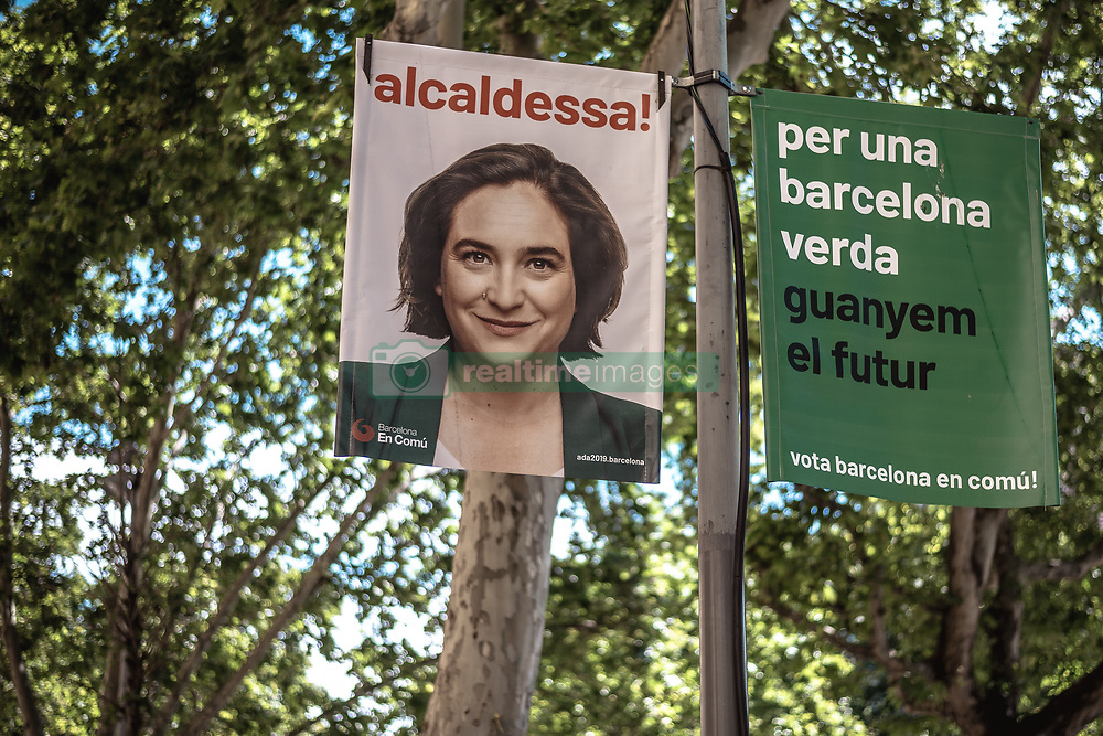 May 26, 2019 - Barcelona, Catalonia, Spain - A placard for Barcelona mayoress Ada Colau is pictured in front of a polling station during the European and municipal elections 2019. (Credit Image: © Matthias OesterleZUMA Wire)
