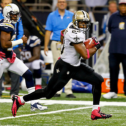 October 7, 2012; New Orleans, LA, USA; New Orleans Saints running back Pierre Thomas (23) breaks away on a run against the San Diego Chargers during the third quarter of a game at the Mercedes-Benz Superdome. The Saints defeated the Chargers 31-24.  Mandatory Credit: Derick E. Hingle-US PRESSWIRE