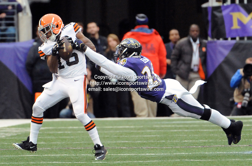 Dec. 28, 2014 - Baltimore, MD, USA - Cleveland Browns' Andrew Hawkins, left, makes a catch in front of Baltimore Ravens' Matt Elam for a first down in the second quarter on Sunday, Dec. 28, 2014 at M&T Bank Stadium in Baltimore, Md. The Ravens won 20-10