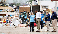 U.S. President Barack Obama surverys damage with Plaza Tower Elementary School Principal Amy Simpson in Moore, Oklahoma, May 26, 2013. Nearly one week earlier a monster tornado ravaged the town, destroying the school and  killing 24 people.