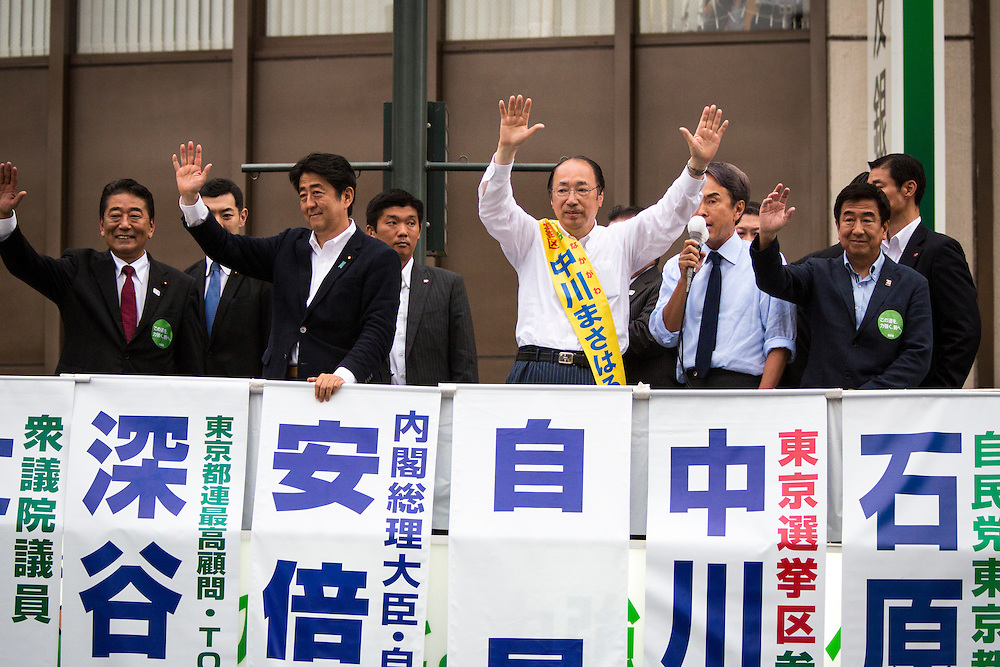 TOKYO, JAPAN - JULY 9 :  Japanese Prime Minister Shinzo Abe (Center left), president of the ruling Liberal Democratic Party (LDP), candidate Masaharu Nakagawa (center right) and the Liberal Democratic Party (LDP) members greets supporters before the campaign speech in the last day of Upper House election campaign outside of Asakusa Station in Tokyo, Japan on July 9, 2016. Tomorrow, July 10, 2016 will be the first Upper house election nation-wide in Japan that 18 years old can vote after government law changes its voting age from 20 years old to 18 years old. (Photo by Richard Atrero de Guzman/NURPhoto)
