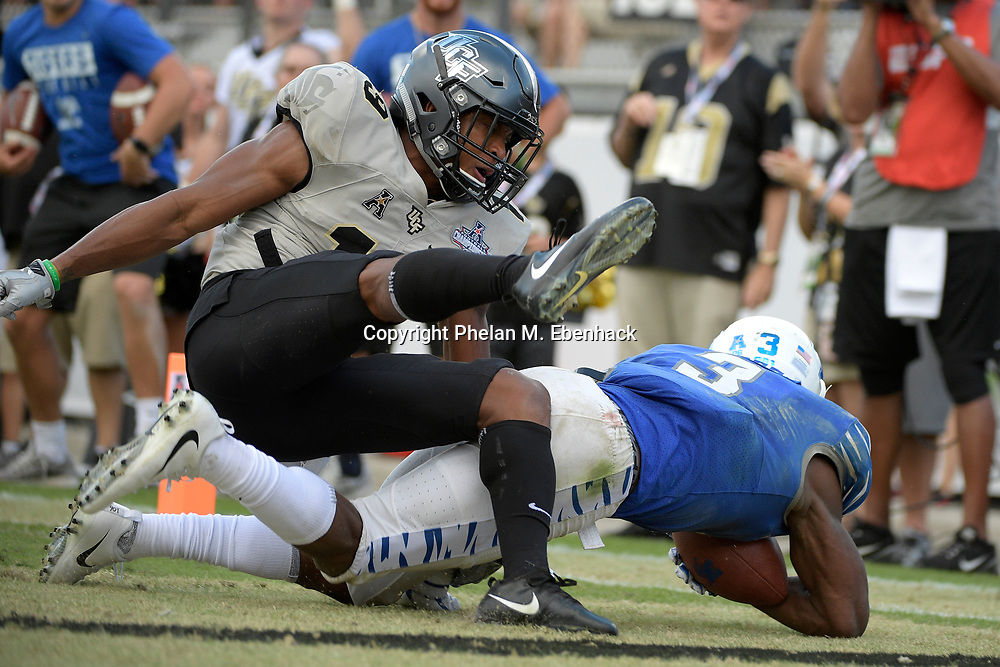 Memphis wide receiver Anthony Miller (3) scores a touchdown in front of Central Florida defensive back Mike Hughes (19) during the second half of the American Athletic Conference championship NCAA college football game Saturday, Dec. 2, 2017, in Orlando, Fla. Central Florida won 62-55. (Photo by Phelan M. Ebenhack)