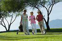 Three women walking on golf course