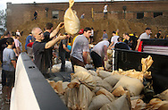 Massive flooding has covered the Midwest section of the United States. In Cedar Rapids, Iowa over 400 blocks were underwater. Other towns are now bracing for the water as it continues downstream.///Volunteers load sandbags onto a pickup which is going to Mercy Hospital in Cedar Rapids, Iowa.