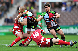 Harlequins fullback Mike Brown is double-tackled in possession - Photo mandatory by-line: Patrick Khachfe/JMP - Tel: Mobile: 07966 386802 12/10/2013 - SPORT - RUGBY UNION - Twickenham Stoop - London - Harlequins V Scarlets - Heineken Cup