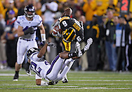 October 15, 2011: Iowa Hawkeyes wide receiver Keenan Davis (6) pulls down a pass as he is hit by Northwestern Wildcats cornerback Demetrius Dugar (22) during the first half of the NCAA football game between the Northwestern Wildcats and the Iowa Hawkeyes at Kinnick Stadium in Iowa City, Iowa on Saturday, October 15, 2011. Iowa defeated Northwestern 41-31.