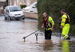 © Licensed to London News Pictures. 25/09/2014. Bristol, UK.  Flooding in Fisher Road and Fisher Avenue from a burst water main.  Many people were evacuated from their homes, some by boat, as water came up as high as their windows . Photo credit : Simon Chapman/LNP
