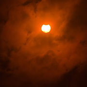 Start of the partial eclipse glimpsed through the clouds, Huangshan, China, 22 July 2009