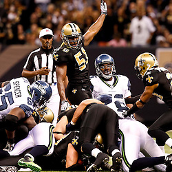 November 21, 2010; New Orleans, LA, USA; New Orleans Saints linebacker Jonathan Vilma (51) signals the that linebacker Scott Shanle (58) recovered a fumble during the second half against the Seattle Seahawks at the Louisiana Superdome. The Saints defeated the Seahawks 34-19. Mandatory Credit: Derick E. Hingle