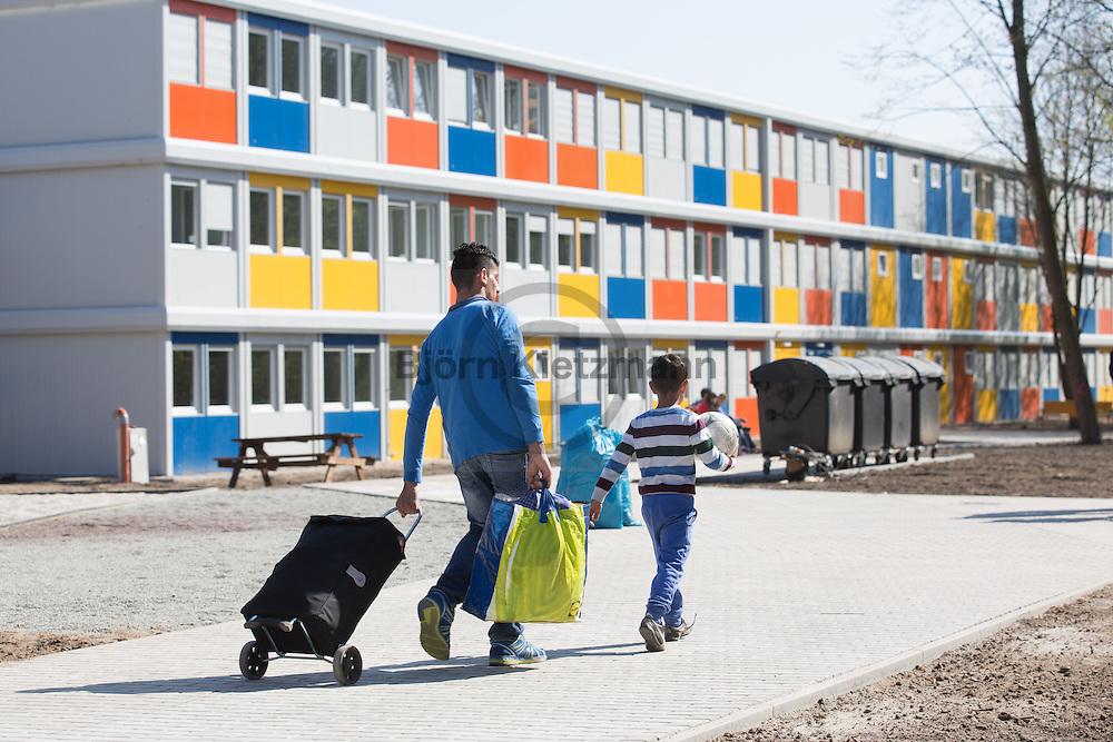 Berlin, Germany - 23.04.2015 <br /> <br /> In Berlin-Buch opens the second new container refugee shelter in Berlin. The first 75 residents moved in during the day. The partially still under construction facility is dimensioned for 480 people.<br /> <br /> In Berlin-Buch hat das zweite Berlier-Container-Fluechtlingsheim eroeffnet. Die ersten 75 Bewohner zogen im Laufe des Tages ein. Die sich teilweise noch im Bau befindliche Einrichtung ist f&uuml;r 480 Personen ausgelegt.<br /> <br /> Photo: Bjoern Kietzmann
