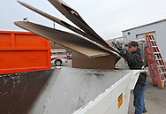 Seth Hinrichs, of Cedar Rapids, throws cardboard in a recycling bin at Overhead Door Company, 6515 4th Street SW in Cedar Rapids on Monday afternoon, November 21, 2011. (Stephen Mally/Freelance)