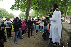 """© Licensed to London News Pictures.  10/09/2017; Bristol, UK. ISHMAEL SALI, an activist from London and supporter of the Sufi interpretation of Islam, speaks to a group called British and Immigrants United Against Terrorism who joined forces with another group called Gays Against Sharia to stage a demonstration in Bristol city centre numbering about 50 people. A counter-protest was also held called 'Stand Up To Racism and Bigotry'. A statement issued to oppose the march says that the demonstrators """"claim falsely that they are representing the views of the LGBT+ community in Bristol,"""" adding: """"In fact, none of the organisers are LGBT+ and all the proposed speakers come from outside Bristol."""" A heavy police presence Police with riot vans dogs and horses were in attendance. Police banned face coverings, masks, banners and flags 'that might incite hatred' ahead of today's protests. Picture credit : Simon Chapman/LNP"""