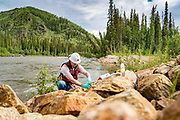 An environmental scientist checks the water quality of the Goodpaster River, a 91-mile tributary of the Tanana River,  in interior Alaska.