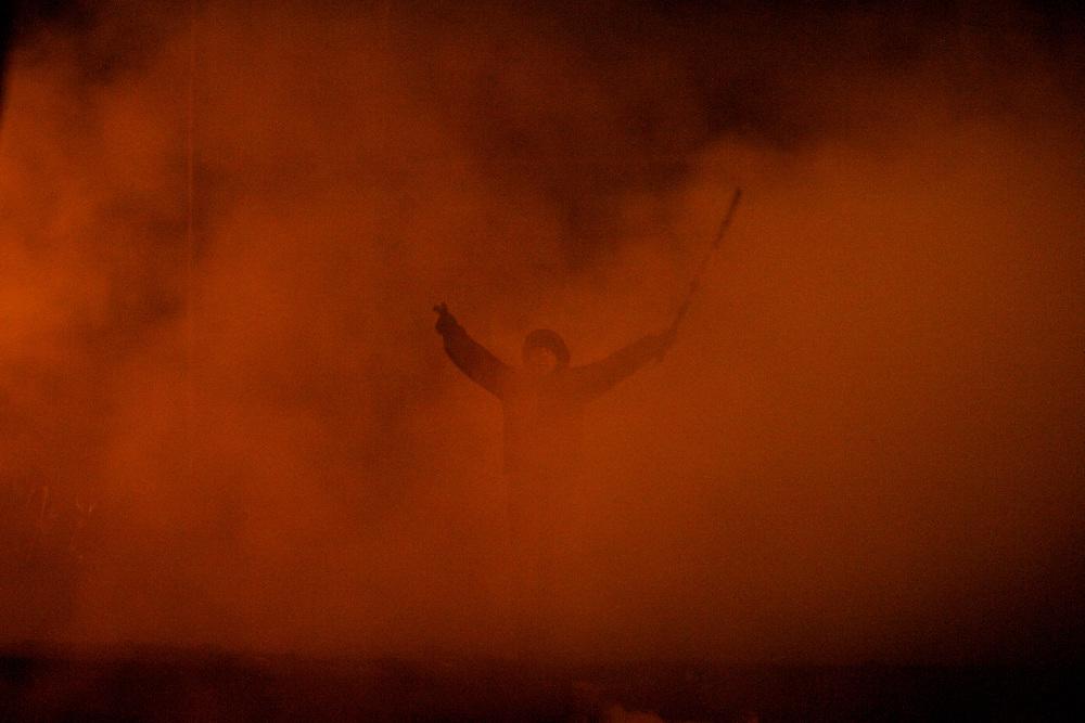 January 24, 2014 - Kiev, Ukraine: A protestor, evolved in smoke, shouts provocative words towards the Ukrainian riot police forces at a defensive barricade near Dynamo Kiev's stadium in central Kiev. (Paulo Nunes dos Santos)
