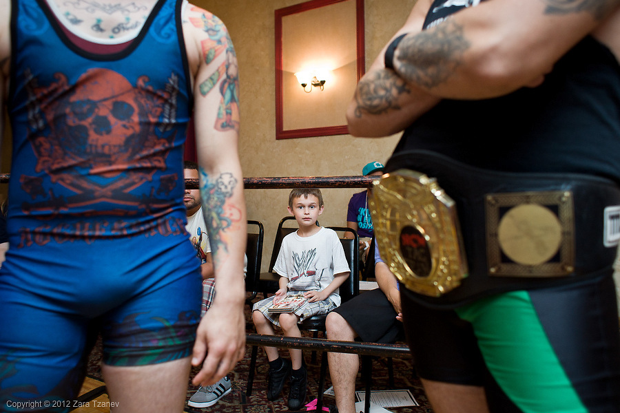 June 29, 2012 -- Joey Connolly, 8 of Dedham watches as wrestlers spill onto the ring during Northeast Championship Wrestling's PAYBACK at the Jacob Jones VFW Post in  Dedham, on Friday, June 29, 2012.