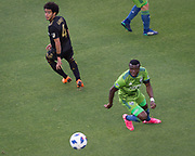 Seattle Sounders defender Nouhou Tolo (5) moves the ball during a MLS soccer match in the inaugural game at Banc of California Stadium in Los Angeles, Sunday, April 29, 2018. LAFC defeated the Sounders 1-0. (Eddie Ruvalcaba/mage of Sport)