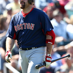March 11, 2011; Fort Myers, FL, USA; Boston Red Sox third baseman Kevin Youkilis (20) reacts after striking out during a spring training exhibition game against the Minnesota Twins at Hammond Stadium.   Mandatory Credit: Derick E. Hingle