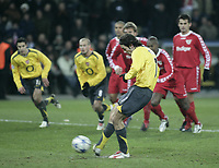 Photo: Barry Bland.<br />FC Thun v Arsenal. UEFA Champions League. 22/11/2005. Robert Pires scores from the penalty spot.