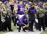 Minnesota Vikings head coach Leslie Frazier kneels and watches from the sideline as the Washington Redskins march down the field hoping to score the game tying touchdown late in the fourth quarter during the NFL week 10 football game against the Washington Redskins on Thursday, Nov. 7, 2013 in Minneapolis. The Vikings won the game 34-27. ©Paul Anthony Spinelli
