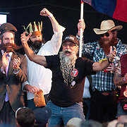 Paul Beisser of Santa Cruz, California celebrates a second place finish in the freestyle category of the Beard Team USA National Beard and Mustache Championships in Bend, Oregon on Saturday, June 5, 2010.
