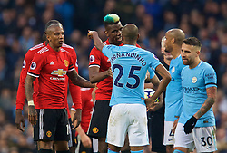 MANCHESTER, ENGLAND - Saturday, April 7, 2018: Manchester United's Paul Pogba clashes with Manchester City's Fernando Luiz Roza 'Fernandinho' during the FA Premier League match between Manchester City FC and Manchester United FC at the City of Manchester Stadium. (Pic by David Rawcliffe/Propaganda)