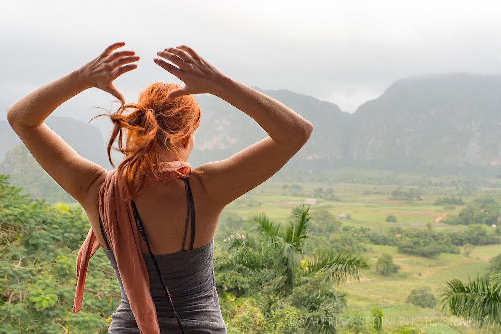 A tourist admires the valley of Vinales from a viewpoint up a hill, 6 kilometres outside the village. Since January 2015 it has been easier for Americans to travel to Cuba and the ones going are allowed to take back to US up to $100 worth of Cuban cigars.