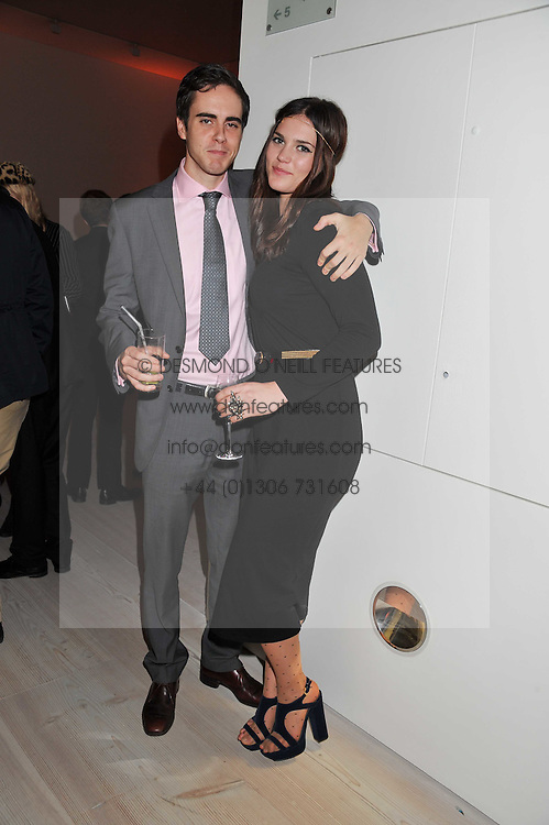 """SAM BRIDGE and ALI CUTLER at the launch of """"Photo-Me by Starck"""" – a photobooth exclusively designed by the world renowned artist and creator Philippe Starck held at The Saatchi Gallery, Duke Of York Square, Kings Road, London on 2nd November 2011."""