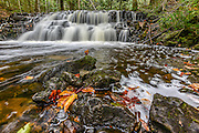 PICTURED ROCKS NATIONAL LAKESHORE - October 2016: Mosquito Falls is seen on an early fall afternoon in Pictured Rocks National Lakeshore near Munising, Michigan in the Upper Peninsula. Although the trail is often muddy and has many tree roots the hike to this falls is only one mile. Photographer Bryan Mitchell was this years Artist in Residence at Pictured Rocks National Lakeshore in the Upper Peninsula of Michigan from Oct. 1-17, 2016 near Munising, Michigan. (Photo by Bryan Mitchell)