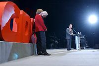 12 JAN 2003, BRAUNSCHWEIG/GERMANY:<br /> Angela Merkel, CDU Bundesvorsitzende, und Edmund Stoiber (verdeckt), CSU, Ministerpraesident Bayern, waehrend der Rede von Christian Wulff, CDU Landesvorsitzender Niedersachsen, (v.L.n.R.), Wahlkampfauftakt der CDU Niedersachsen zur Landtagswahl, Volkswagenhalle<br /> IMAGE: 20030112-01-050<br /> KEYWORDS: Spitzenkandidat, Ministerpr&auml;sident, speech, Logo