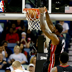 Oct 23, 2013; New Orleans, LA, USA; Miami Heat small forward LeBron James (6) dunks against the New Orleans Pelicans during the first quarter of a preseason game at New Orleans Arena. Mandatory Credit: Derick E. Hingle-USA TODAY Sports