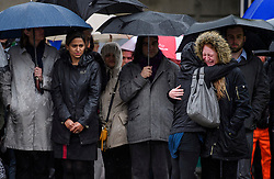© Licensed to London News Pictures. 06/06/2017. London, UK.  Two emotional women embrace during a minutes silence at London Bridge in central London for those who lost their life in a terrorist attack on Saturday evening. Three men attacked members of the public  after a white van rammed pedestrians on London Bridge.   Ten people including the three suspected attackers were killed and 48 injured in the attack. Photo credit: Ben Cawthra/LNP