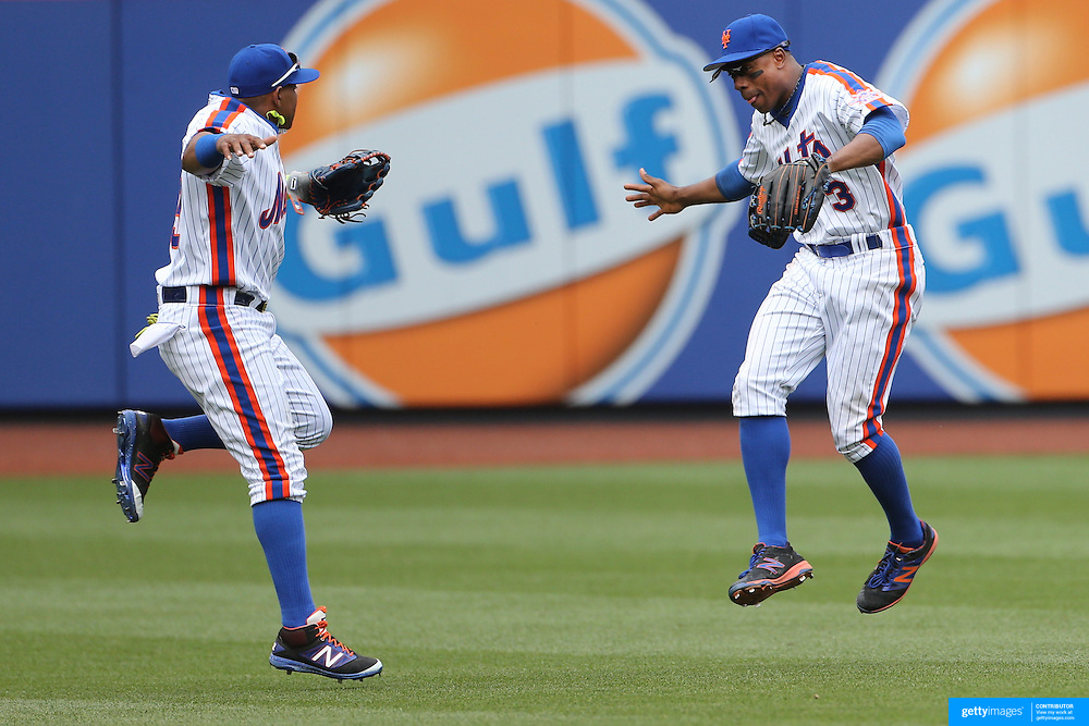 NEW YORK, NEW YORK - May 22:  Yoenis Cespedes #52, (left) and Curtis Granderson #3 of the New York Mets celebrate victory during the Milwaukee Brewers Vs New York Mets regular season MLB game at Citi Field on May 22 2016 in New York City. (Photo by Tim Clayton/Corbis via Getty Images)
