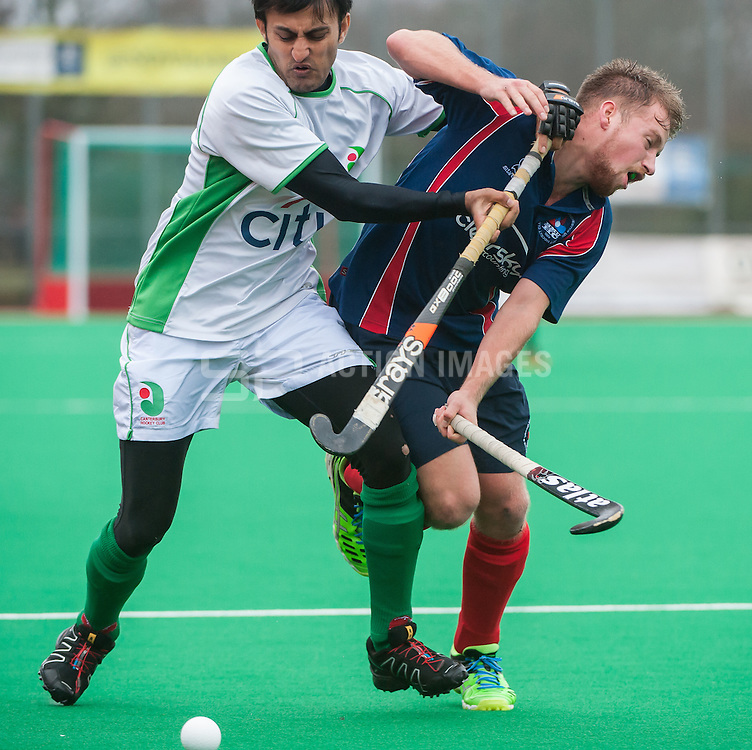 Canterbury's Adnan Zakir battles with Ross Hall of Brooklands. Canterbury v Brooklands - Now: Pensions Hockey League Premier Division, Polo Farm, Canterbury, UK on 28 February 2015. Photo: Simon Parker