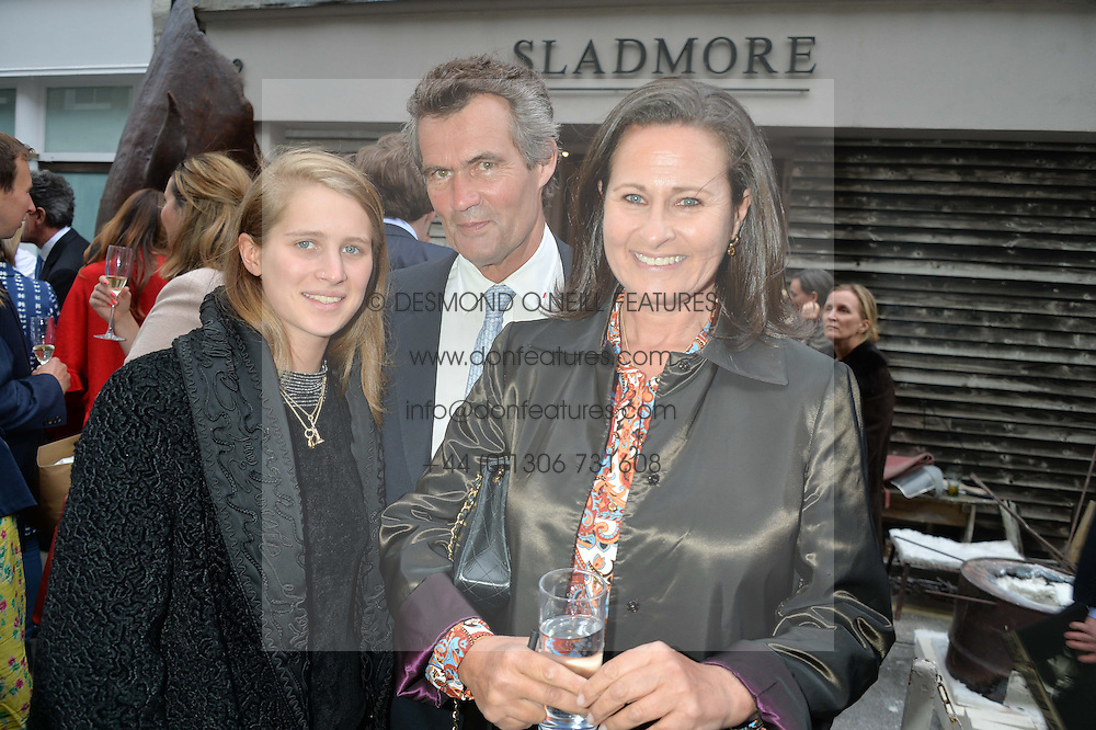 Left to right, LADY LEONORA ALEXANDER, MARTIN LEGGATT and HENRIETTA, COUNTESS OF CALEDON at a private view of work & workings of Nic Fiddian Green - The Studio held at Sladmore Contemporary, 32 Bruton Place, London on 9th June 2015.