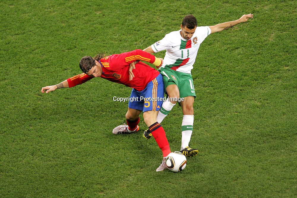 Sergio Ramos  of Spain and Simao of Portugal  during the FIFA World Cup 2010 last 16 match between Spain and Portugal held at The Cape Town Stadium in Green Point, Cape Town, South Africa on the 29th June 2010<br /> <br /> <br /> Photo by Ron Gaunt/SPORTZPICS