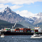 The busy shipping port of Ushuaia, Argentina. The distinctive, sharp triangle-shaped mountain is Monte Olivia (Mount Olivia).
