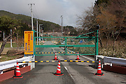 A roadblock on the road to Tsushima Village in the mountains of Fukushima, Japan, Wednesday May 1st 2013 Though outside the 20km exclusion zone, areas to the North West, under a highly radioactive plume emanating from the Fukushima Daichi Plant nuclear plant since the March 11th 2011 disaster, have been closed to access.