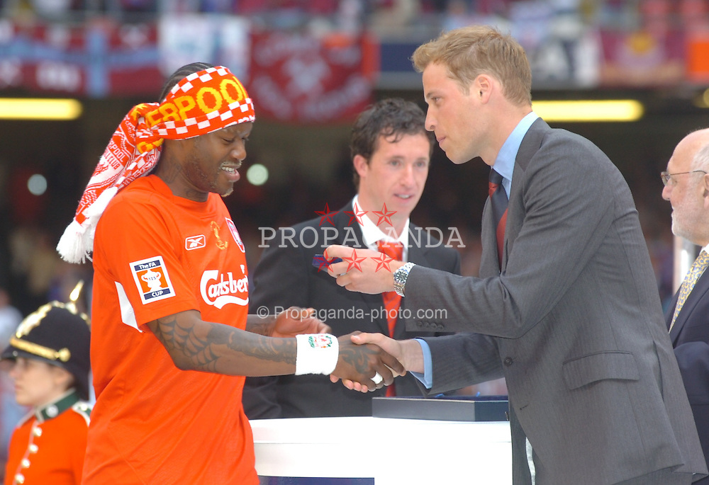 CARDIFF, WALES - SATURDAY, MAY 13th, 2006: Liverpool's Djibril Cisse receives his FA Cup winners' medal from Prince William after the FA Cup Final victory over West Ham United at the Millennium Stadium.  (Pic by Jason Roberts/Propaganda)