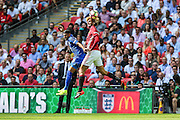 Marouane Fellaini Midfielder of Manchester United out jumps Leicester City Midfielder Riyad Mahrez during the FA Community Shield match between Leicester City and Manchester United at Wembley Stadium, London, England on 7 August 2016. Photo by Shane Healey.